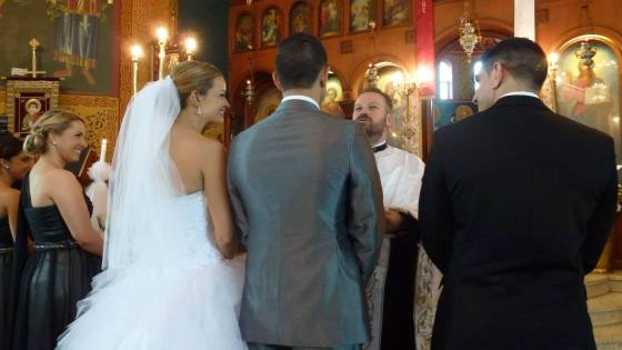 The Bride and Groom with their Koumbari at a Greek orthodox church